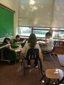 cooperative learning groups working in the literacy lounge